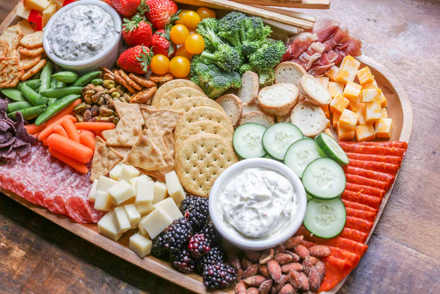 A charcuterie board with fruits and vegetables, making for a healthy appetizer