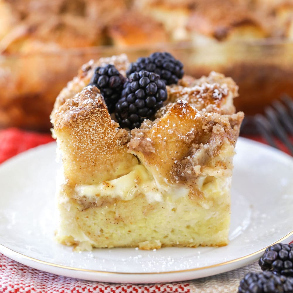 A slice of french toast casserole with cream cheese on a plate