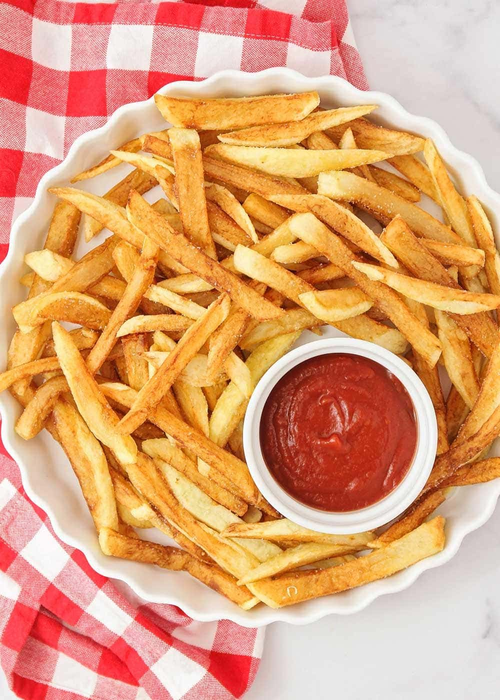 Homemade french fries recipe in dish with ketchup
