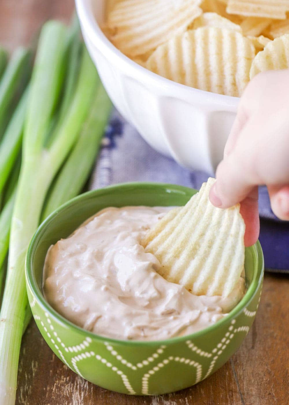 Dipping a chip into homemade french onion dip