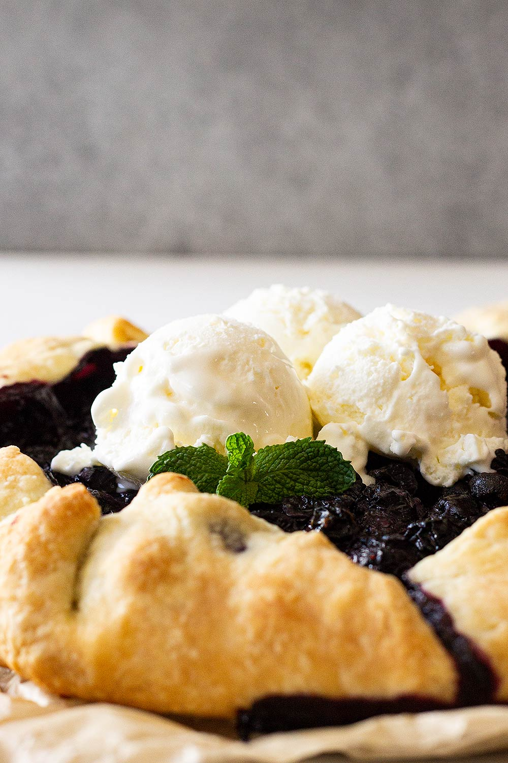 Blueberry galette topped with vanilla ice cream