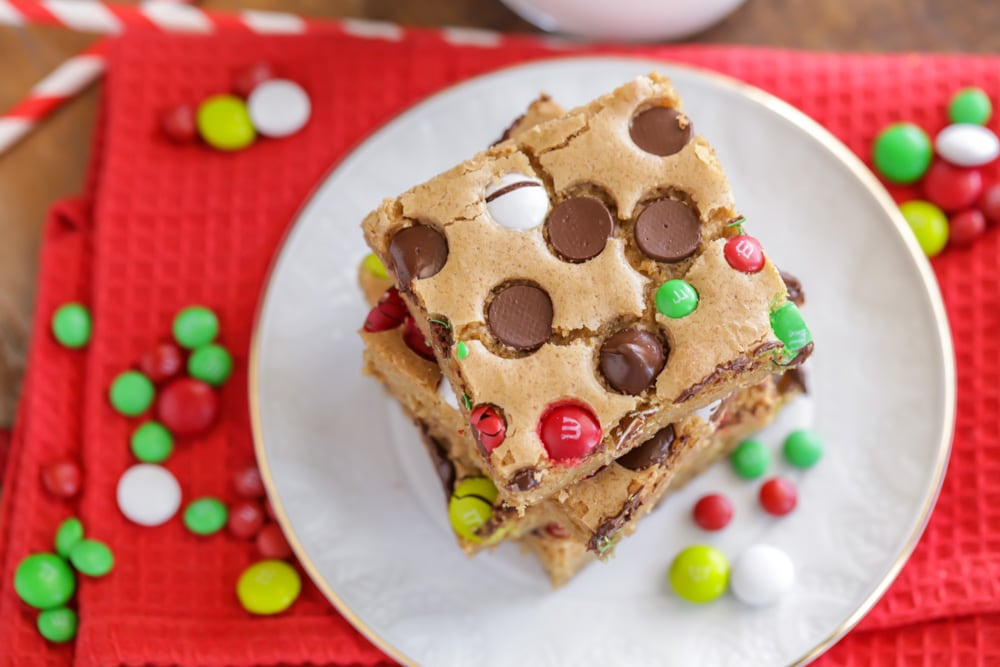 Christmas cookie bars stacked on a white plate