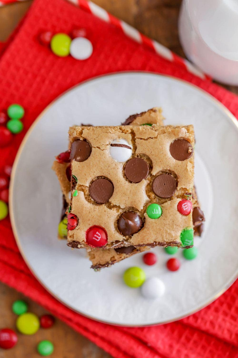 M&M Christmas cookie bars stacked on a white plate