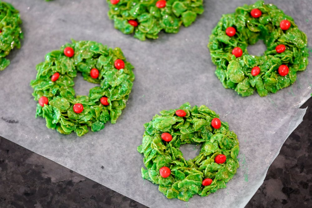 Cornflake Christmas wreaths cooling on wax paper