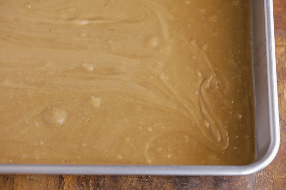 Cookie bar dough in a metal baking pan