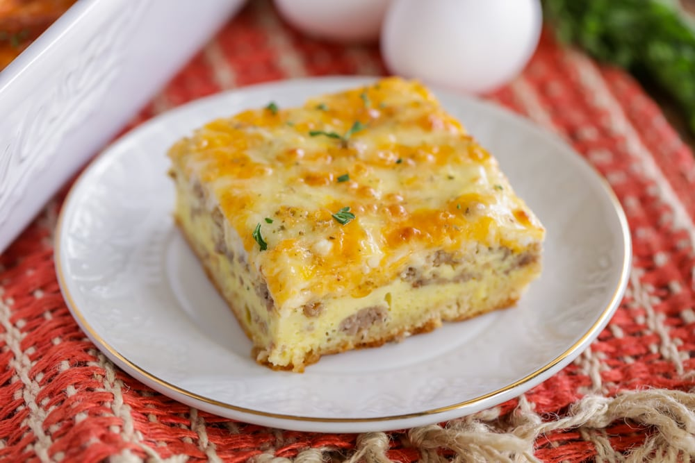 A slice of crescent roll breakfast casserole on a white plate
