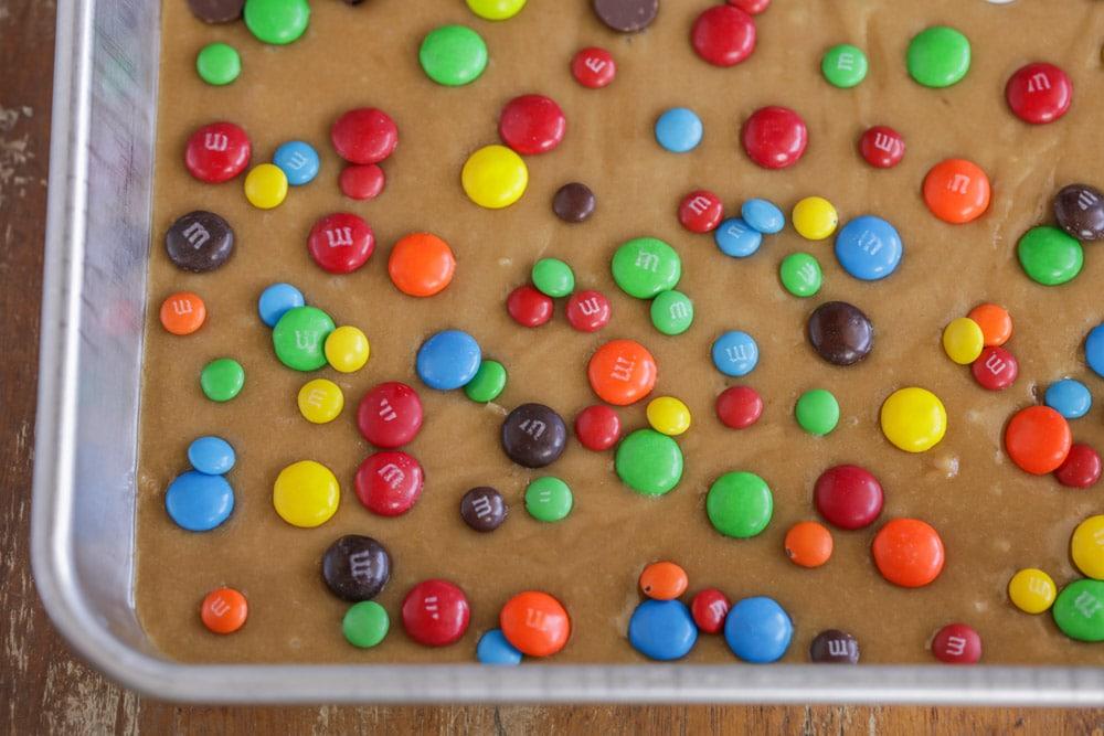 M&M Cookie Bar Recipe in a metal sheet pan