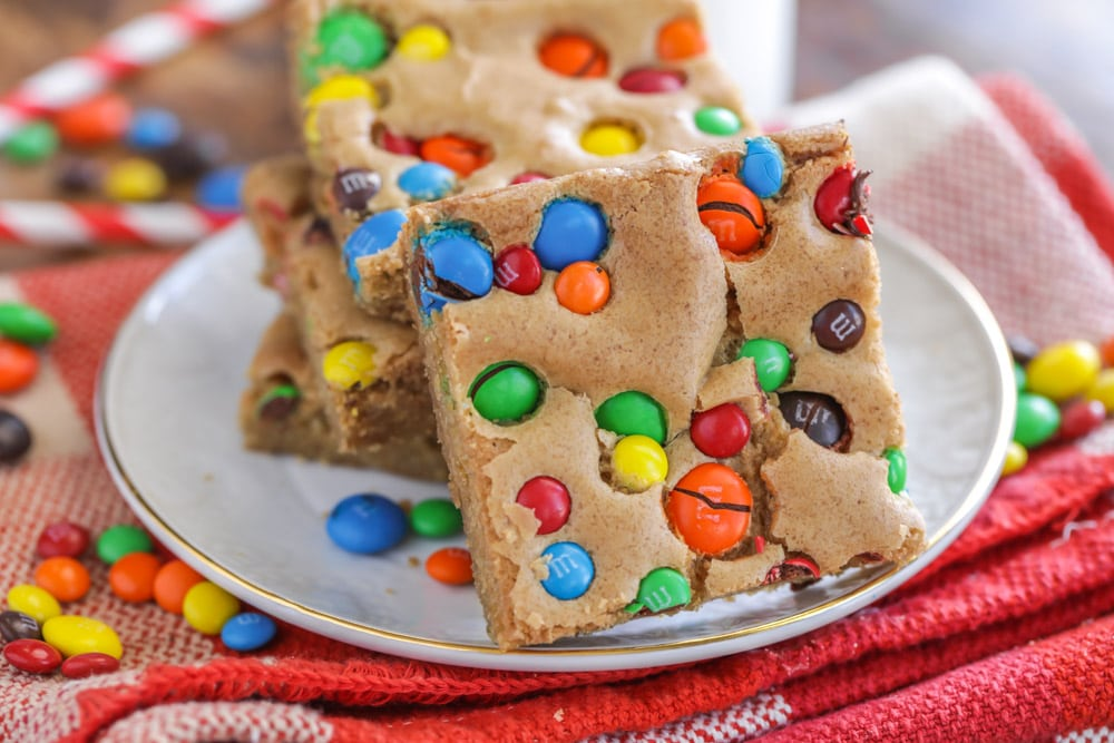M&M Cookie Bars stacked on a white plate
