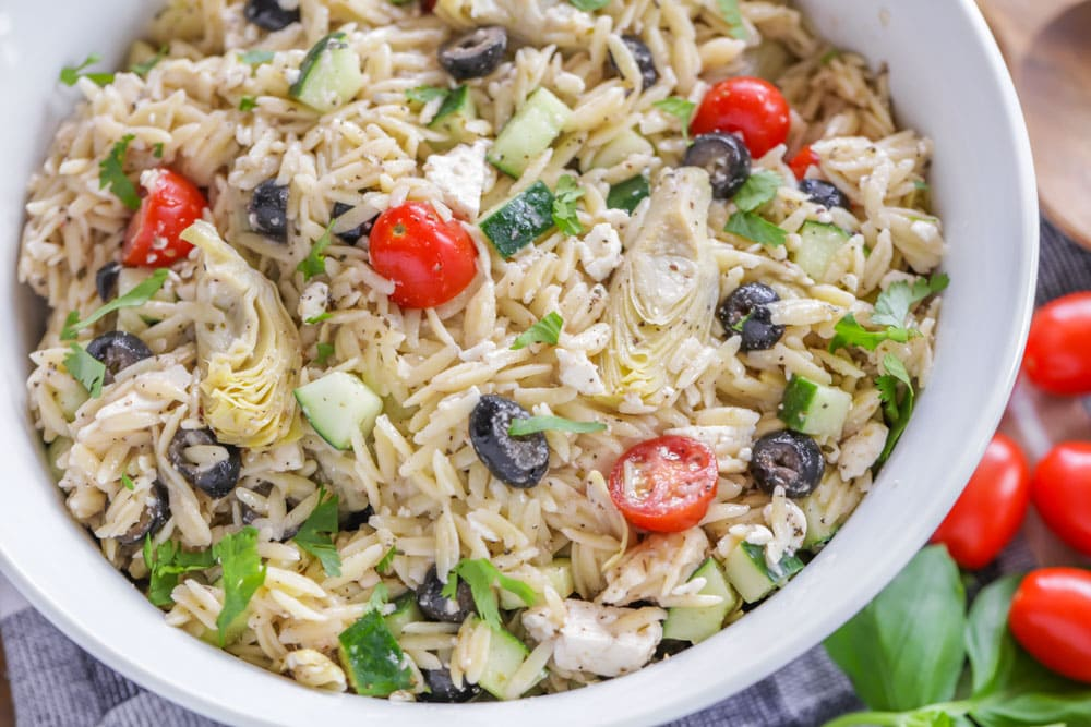 Orzo salad with tomatoes, olives, artichokes, and cucumber