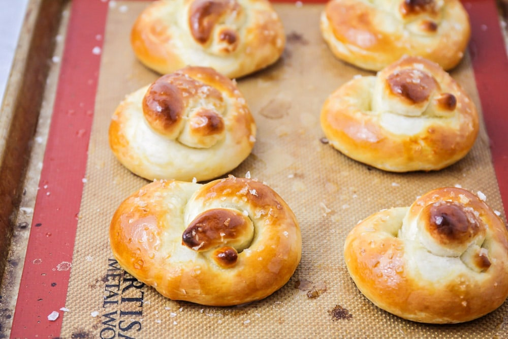 Soft pretzels on baking sheet