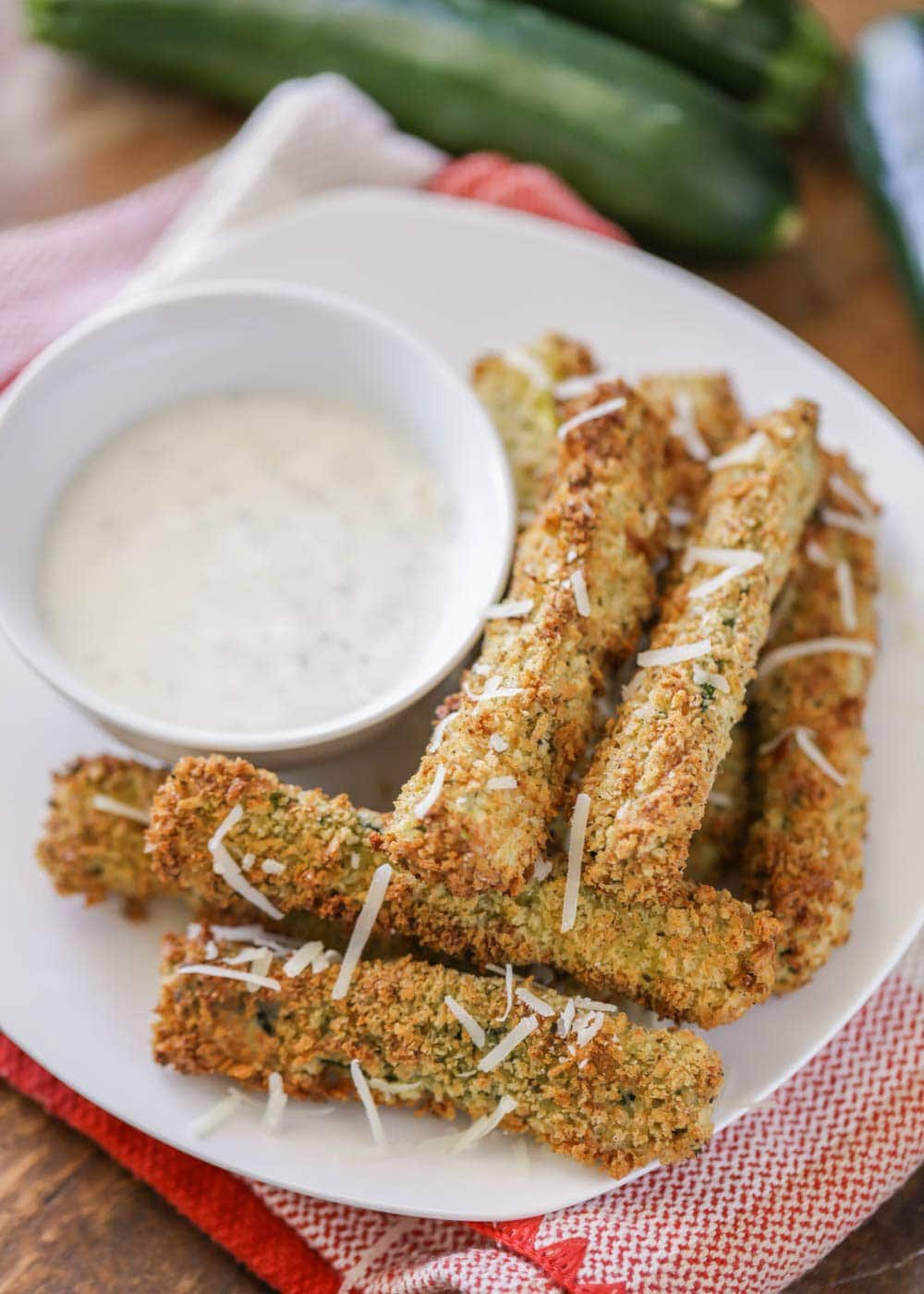 Air fryer zucchini fries on a plate with a side of ranch