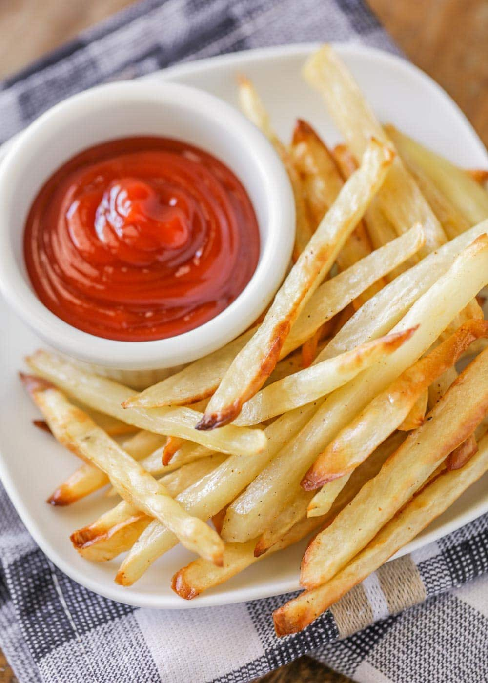 Homemade baked french fries with ketchup on the side