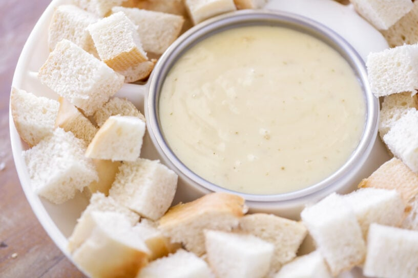 Cheese fondue surrounded by bread chunks