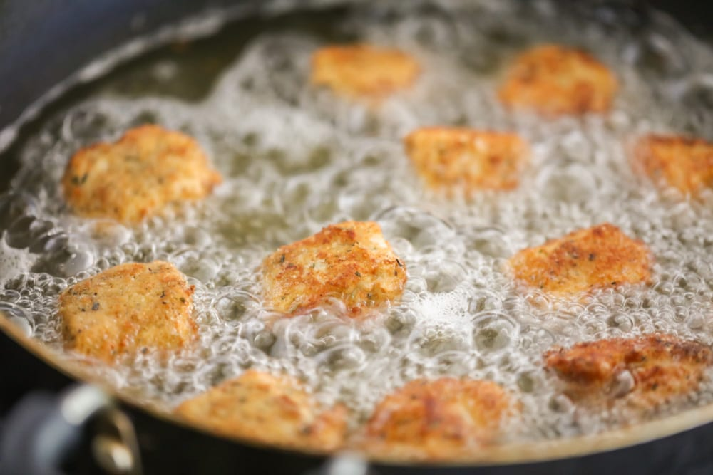 Fried chicken nuggets (in pan in oil)