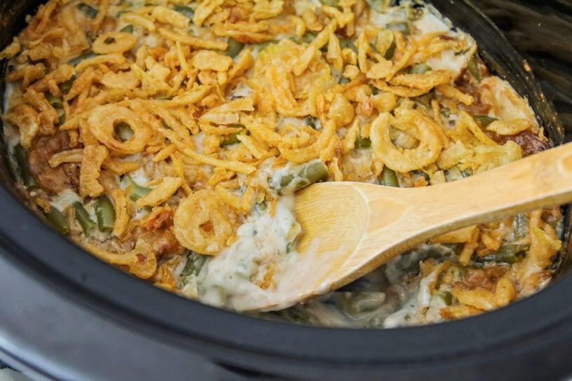 Green bean casserole side dish inside a crock pot