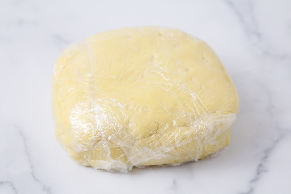 Sugar cookie dough wrapped in plastic wrap