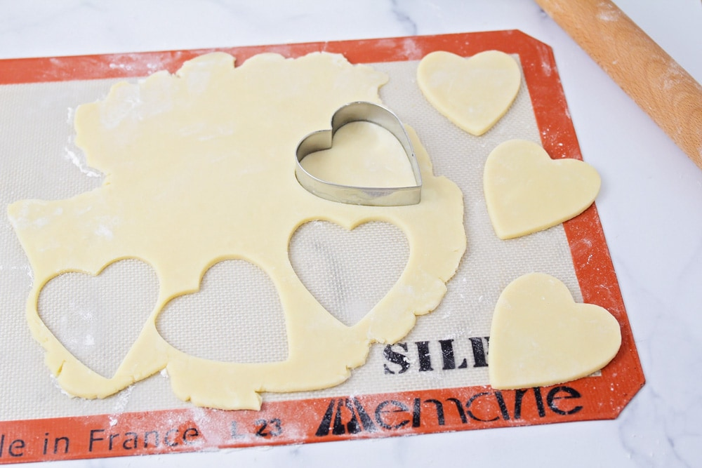 Cutting out heart shaped cookies