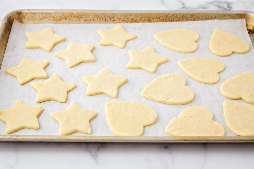 Cream cheese sugar cookies on a baking sheet