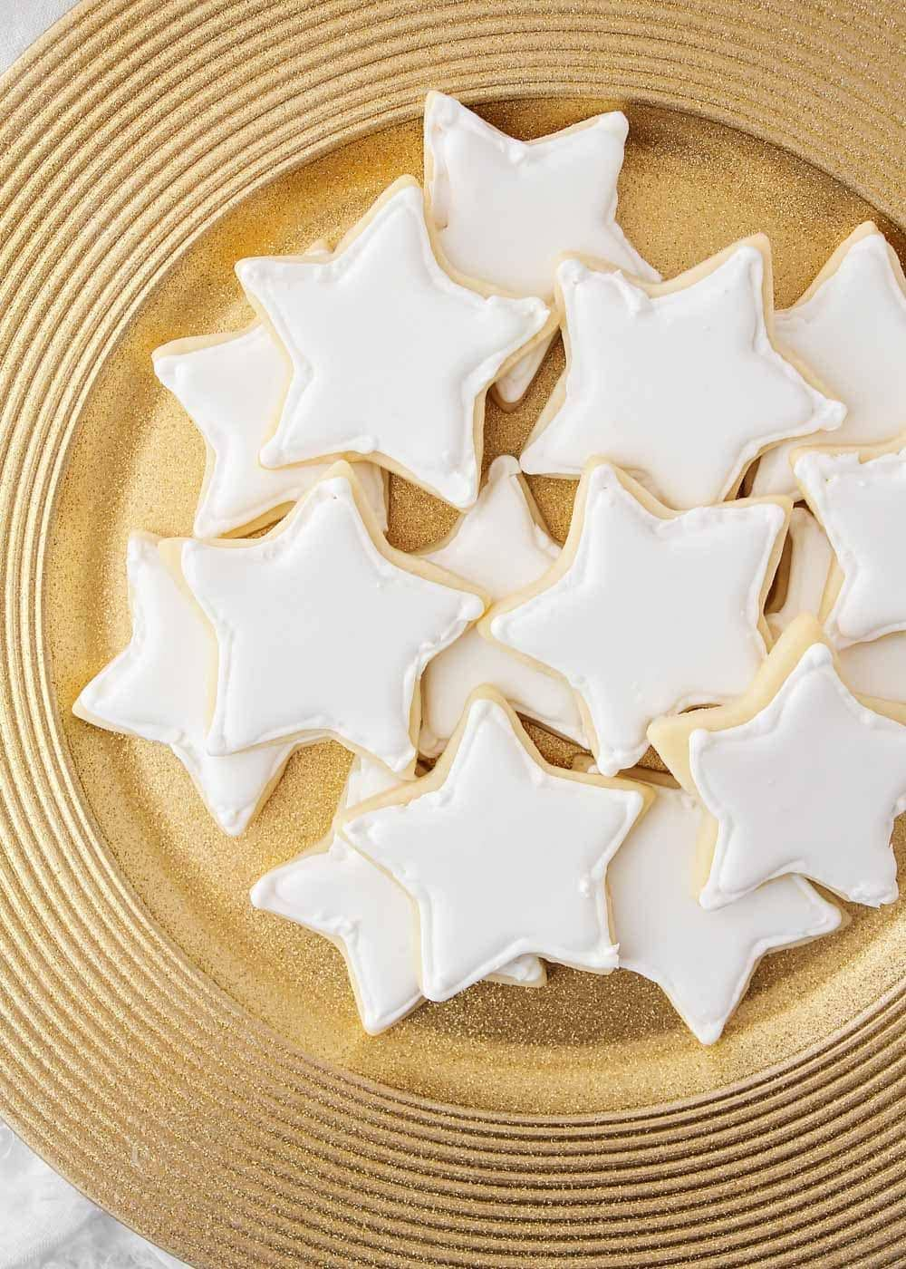 White royal icing on star shaped cookies