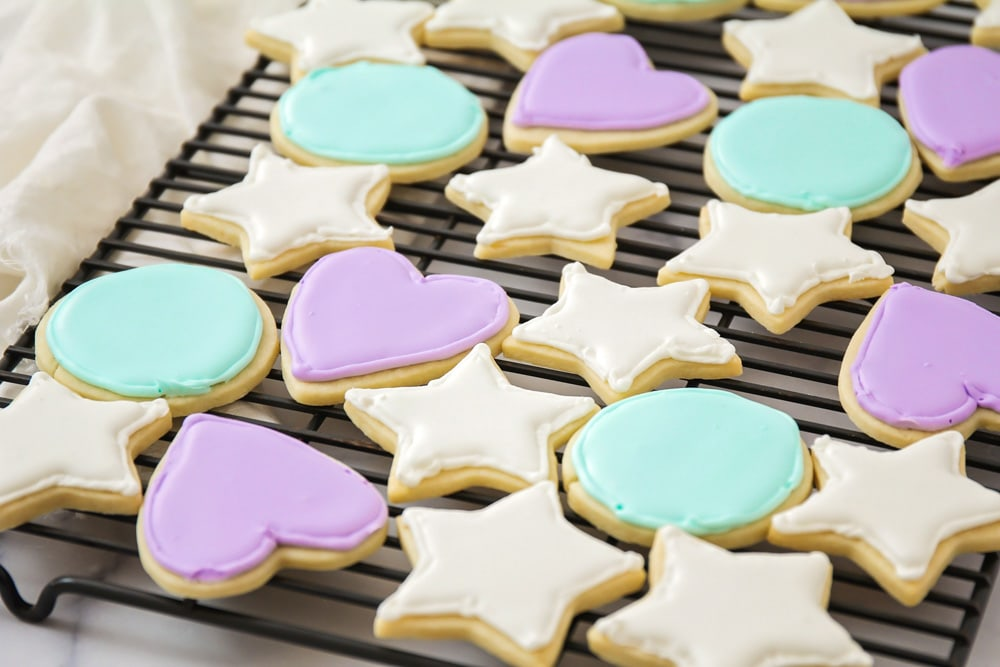 Several colors of royal icing used to decorate sugar cookies