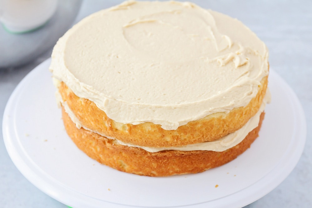 Caramel cake icing on top of a two layer cake