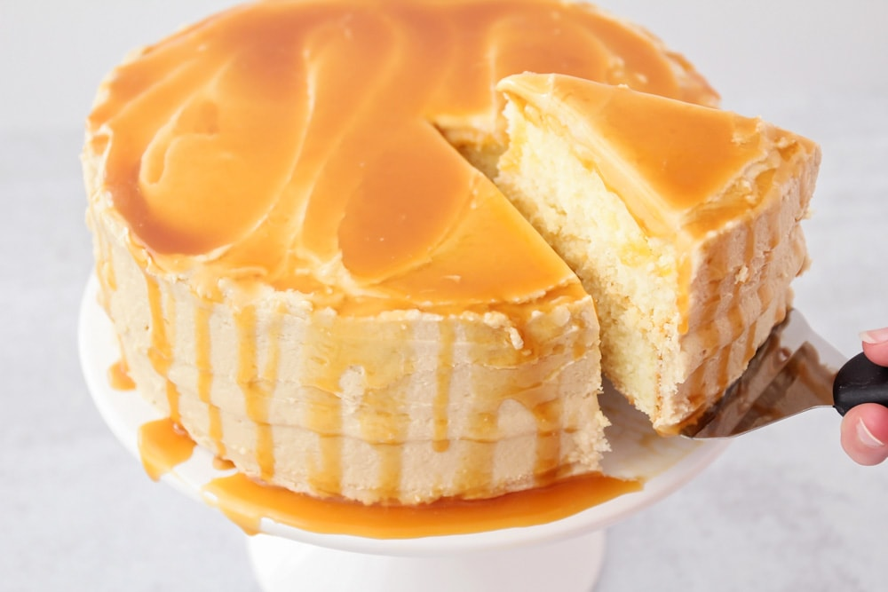 A cake covered with caramel frosting