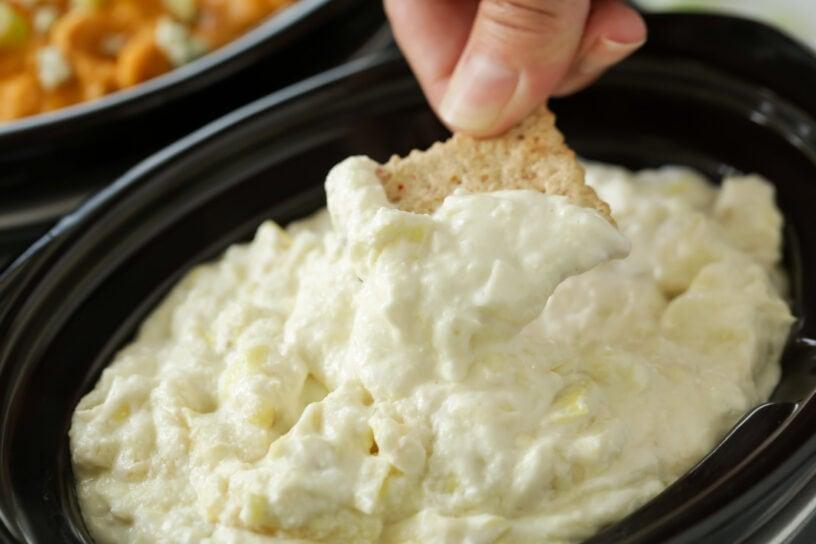 Artichoke dip served in the crockpot as an appetizer
