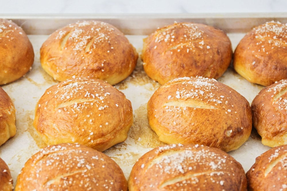 Baked pretzel rolls topped with sea salt