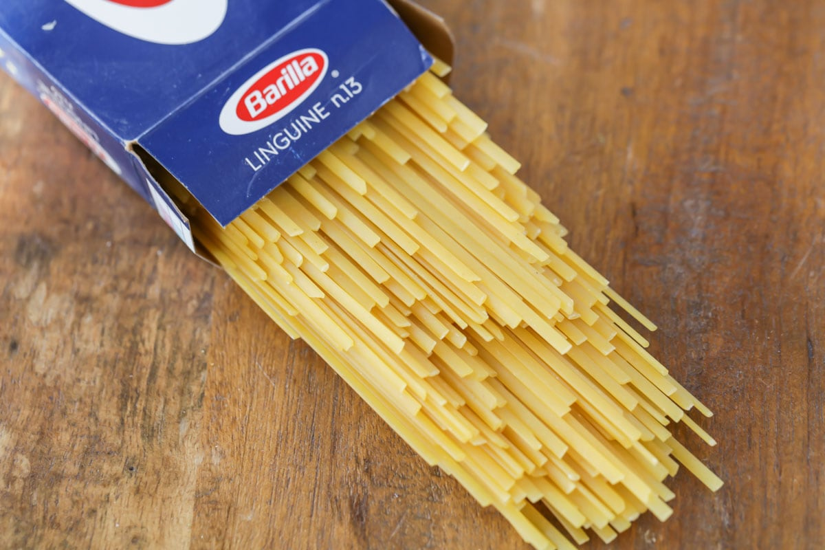 Uncooked linguine coming out of pasta box