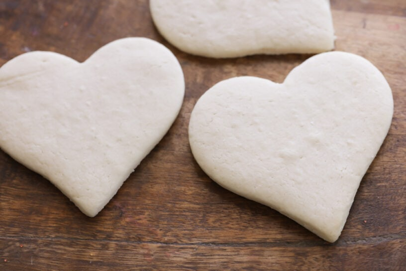 Heart shaped sugar cookies on a wooden surface