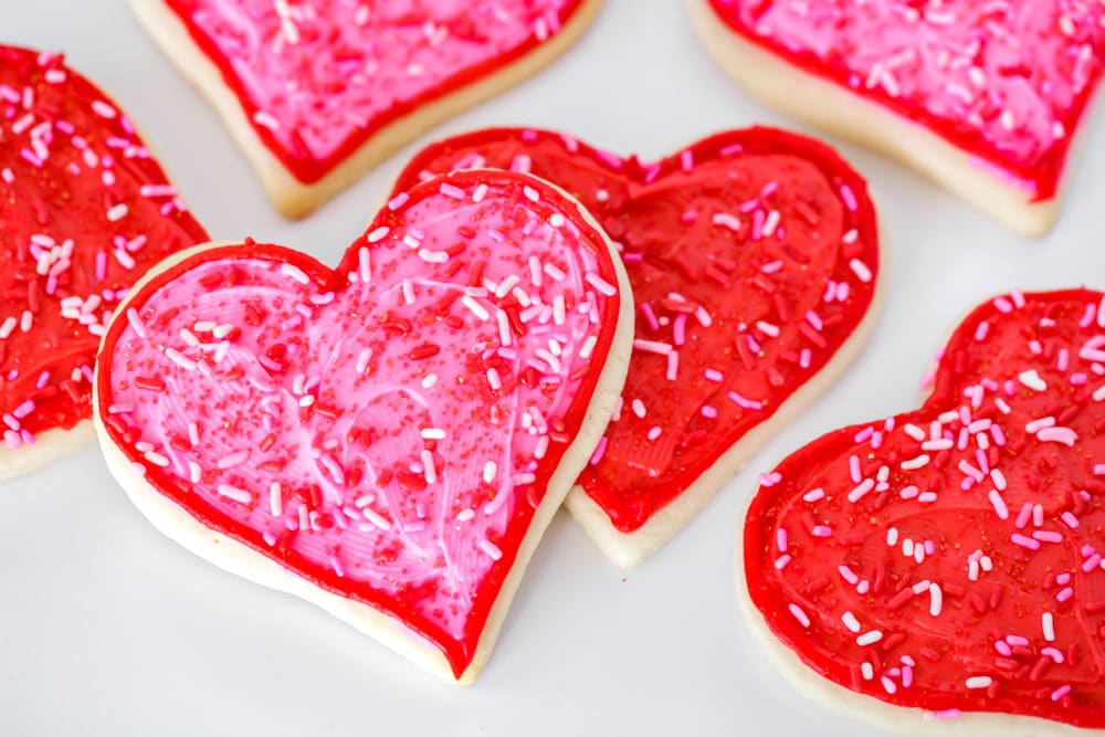 Heart shaped valentine sugar cookies with red and pink frositng