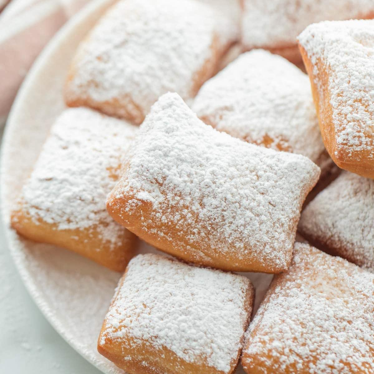 Beignets covered in powder sugar