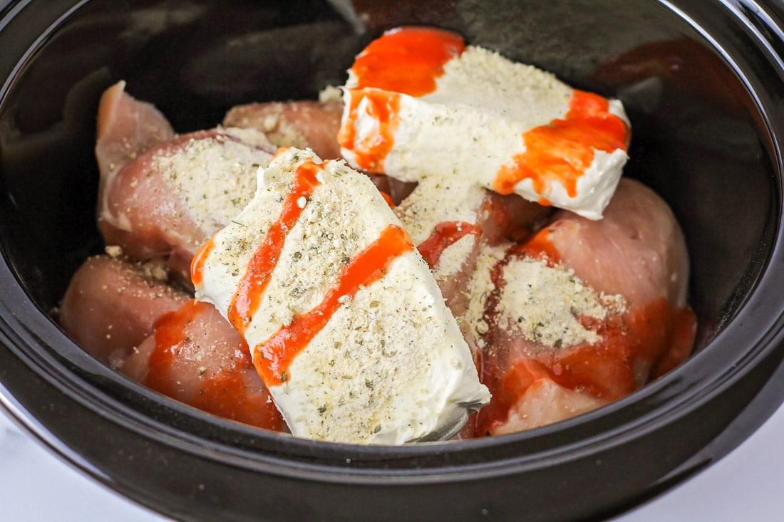 Crack chicken recipe ingredients in a crock pot.