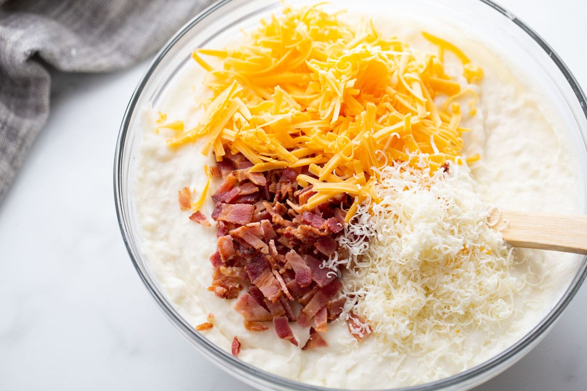 creamed potatoes topped with shredded cheese and crumbled bacon.