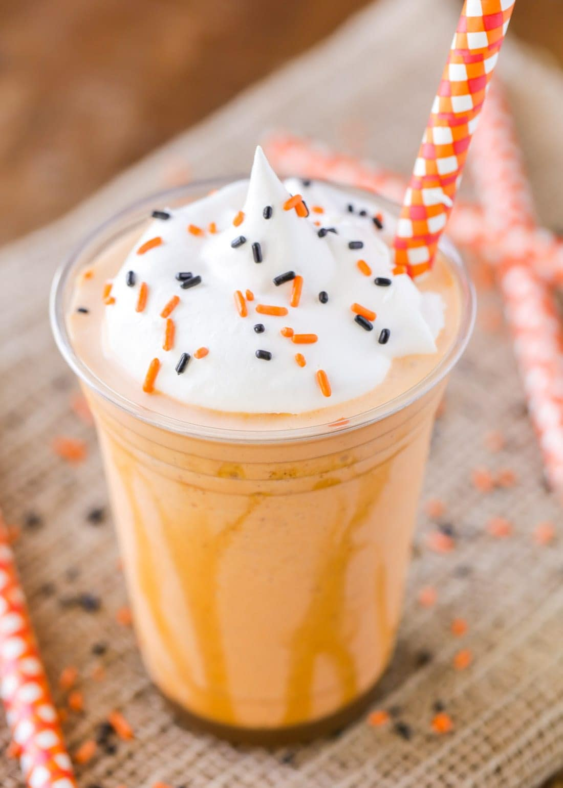 Pumpkin Milkshake recipe in cup with whipped cream and sprinkles