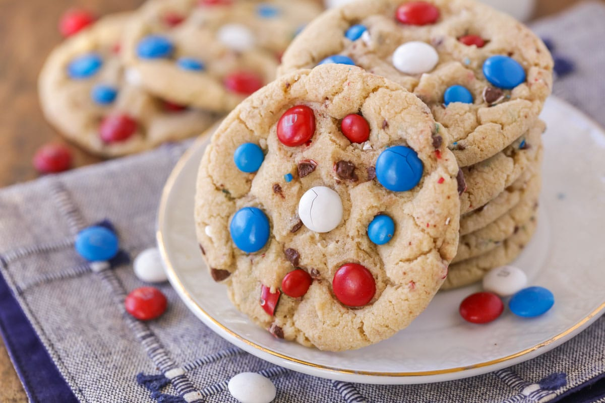 4th of July cookies stacked on a white plate.