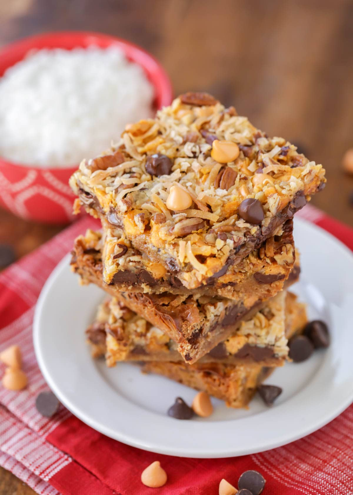 7 layer magic bars stacked on a white plate.