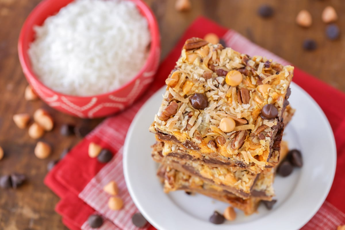 7 layer magic bars stacked on a white plate