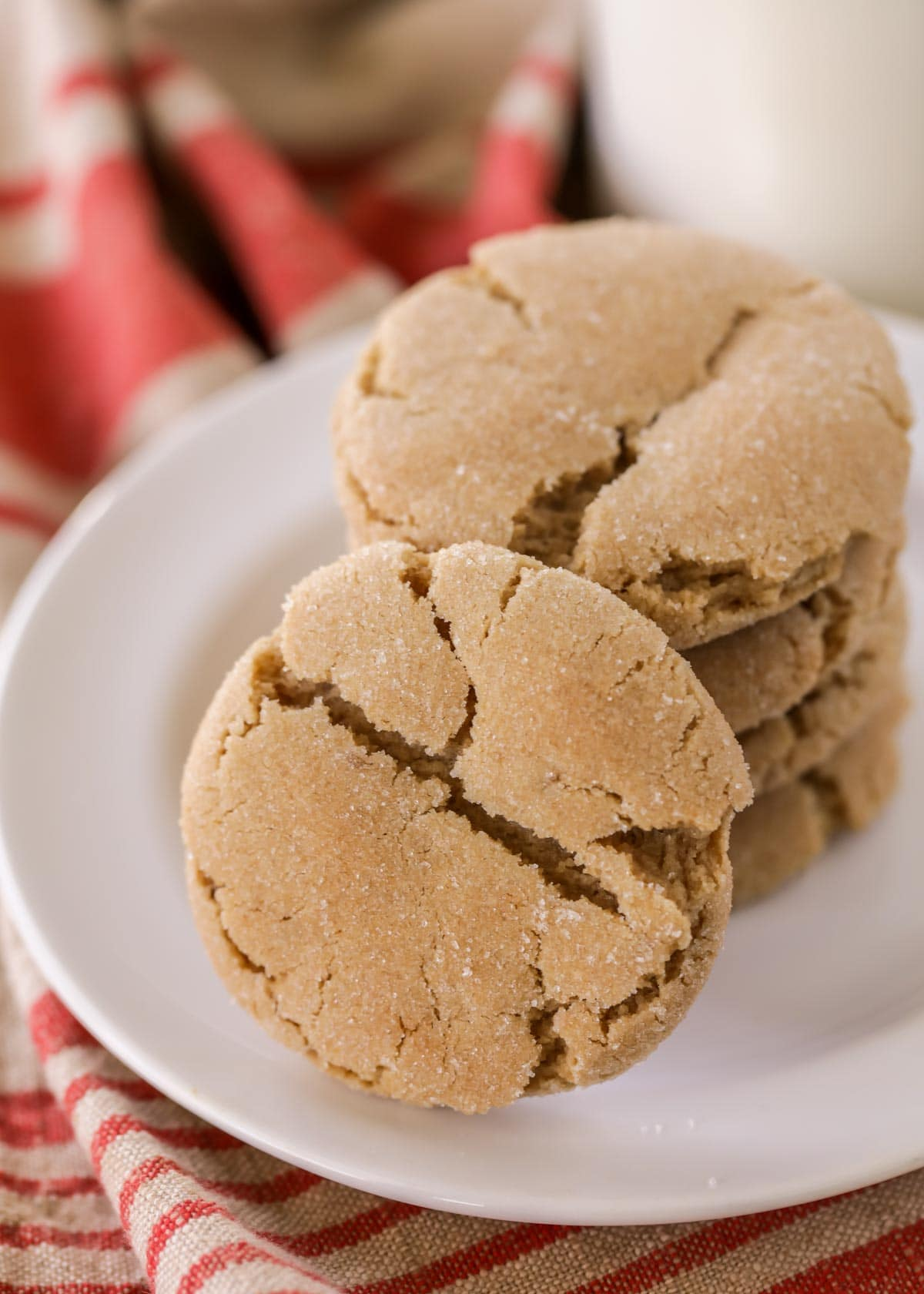 Chewy brown sugar cookies stacked on a white plate