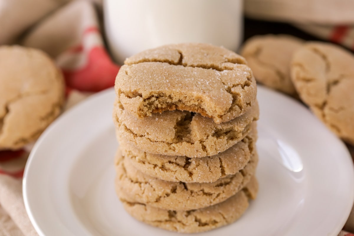 Brown sugar cookies stacked on a white plate