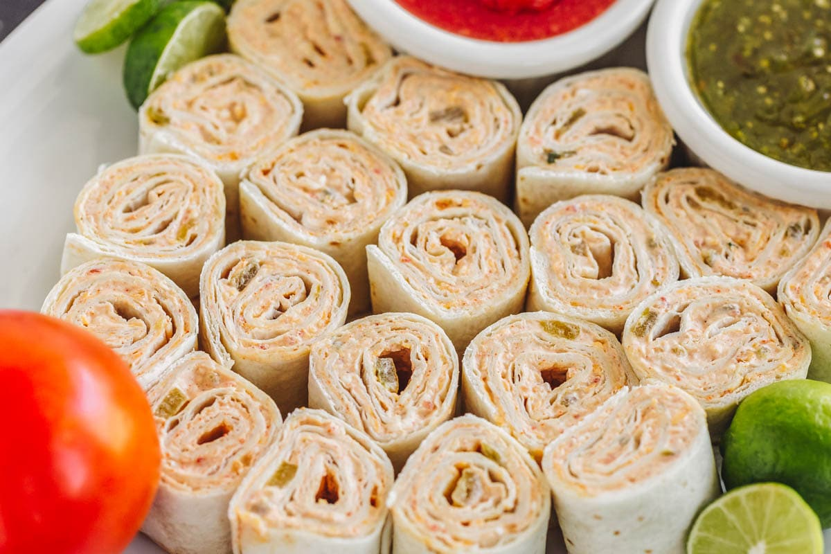 Fiesta pinwheels on a platter with salsa