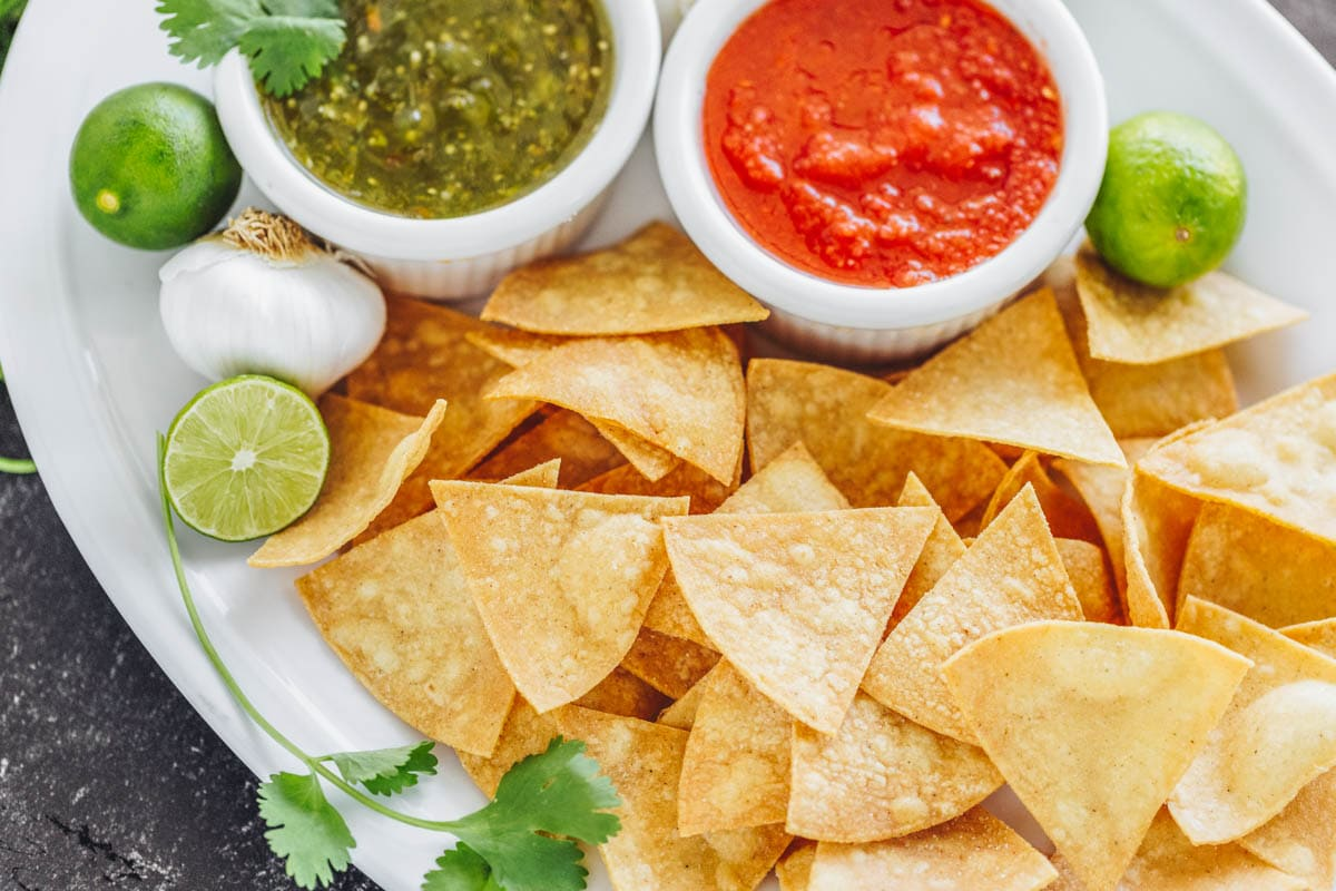 Homemade tortilla chips with salsa on the side