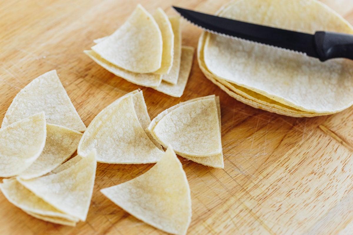 Cutting corn tortillas into tortilla chips