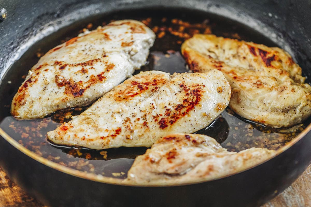 Mexican chicken breasts cooking in a skillet