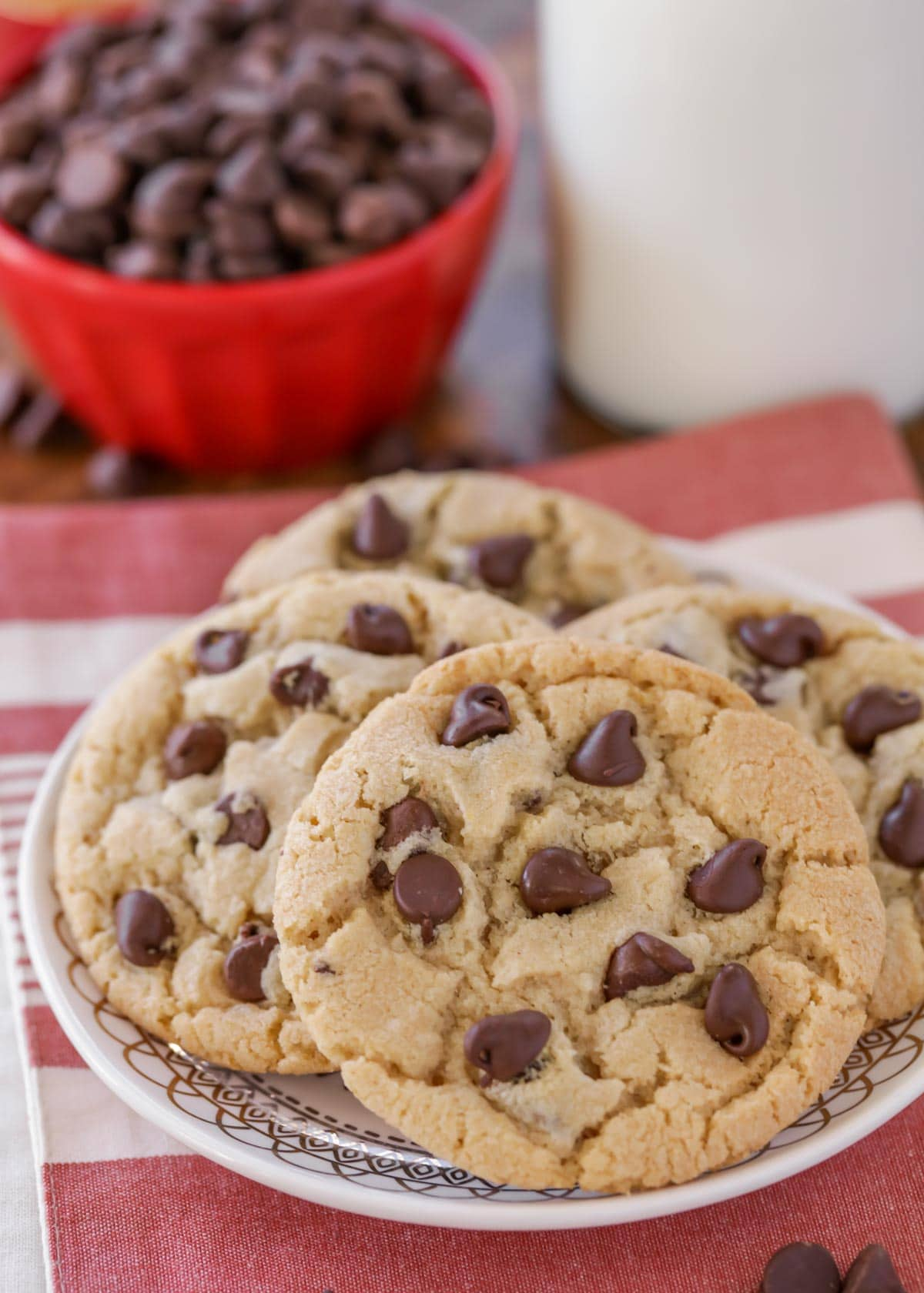 Nestle Toll House chocolate chip cookies staked on a white decorative plate