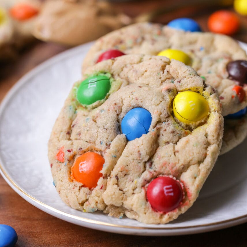A stack of Peanut Butter M&M Cookies on a plate