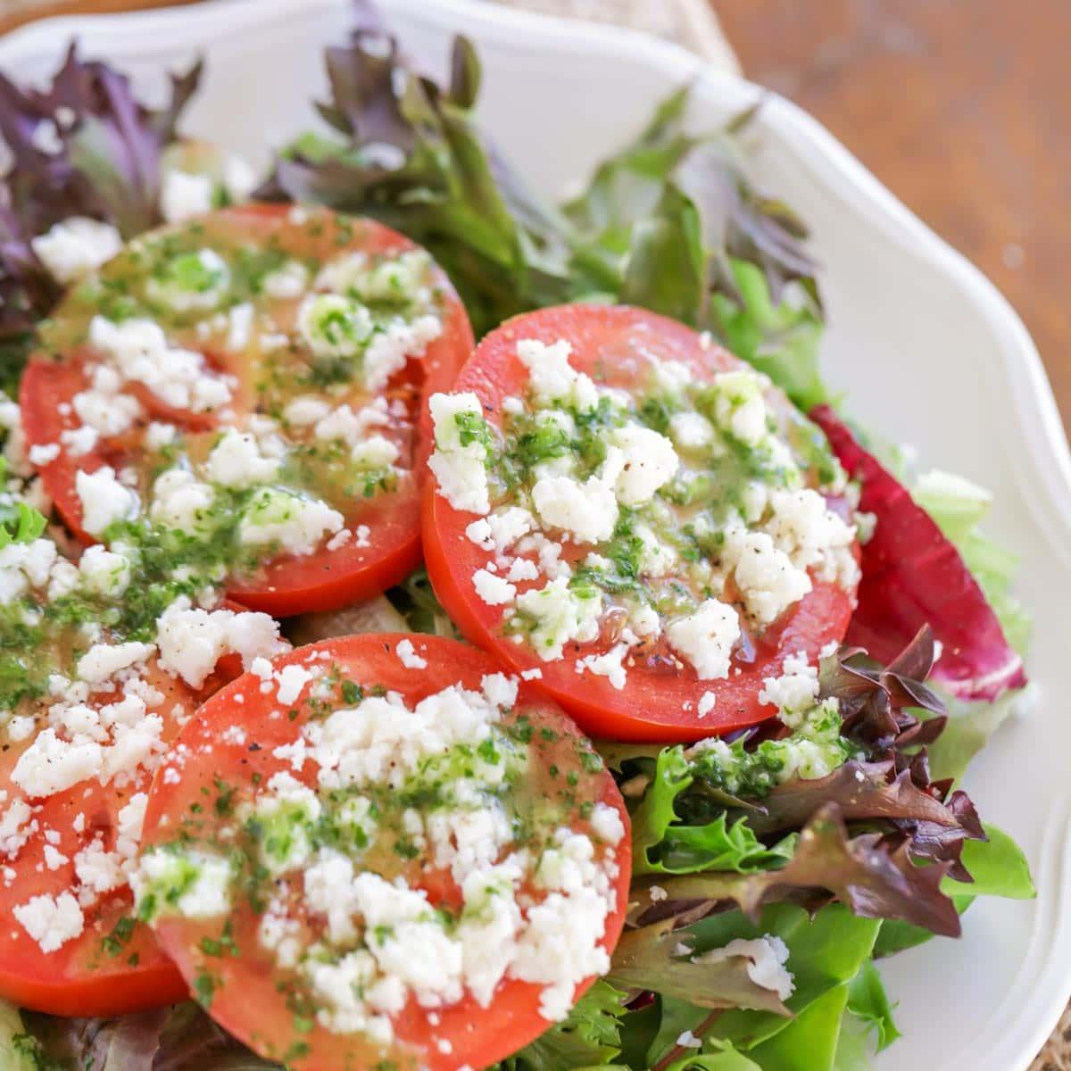 Southwest caprese salad with tomatoes, queso fresco, and cilantro lime vinaigrette