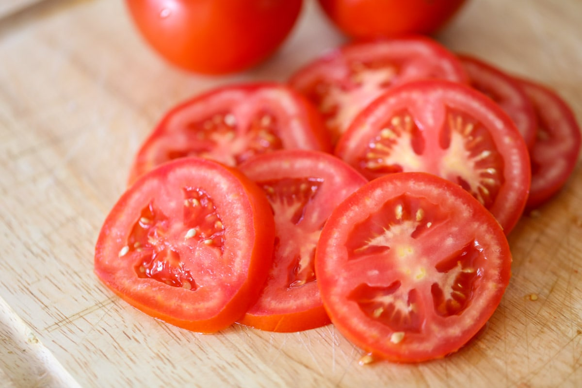 Freshly sliced tomatoes for margherita pizza recipe