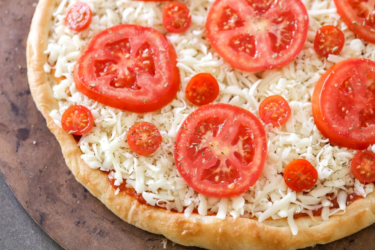 Red tomato pizza before being baked