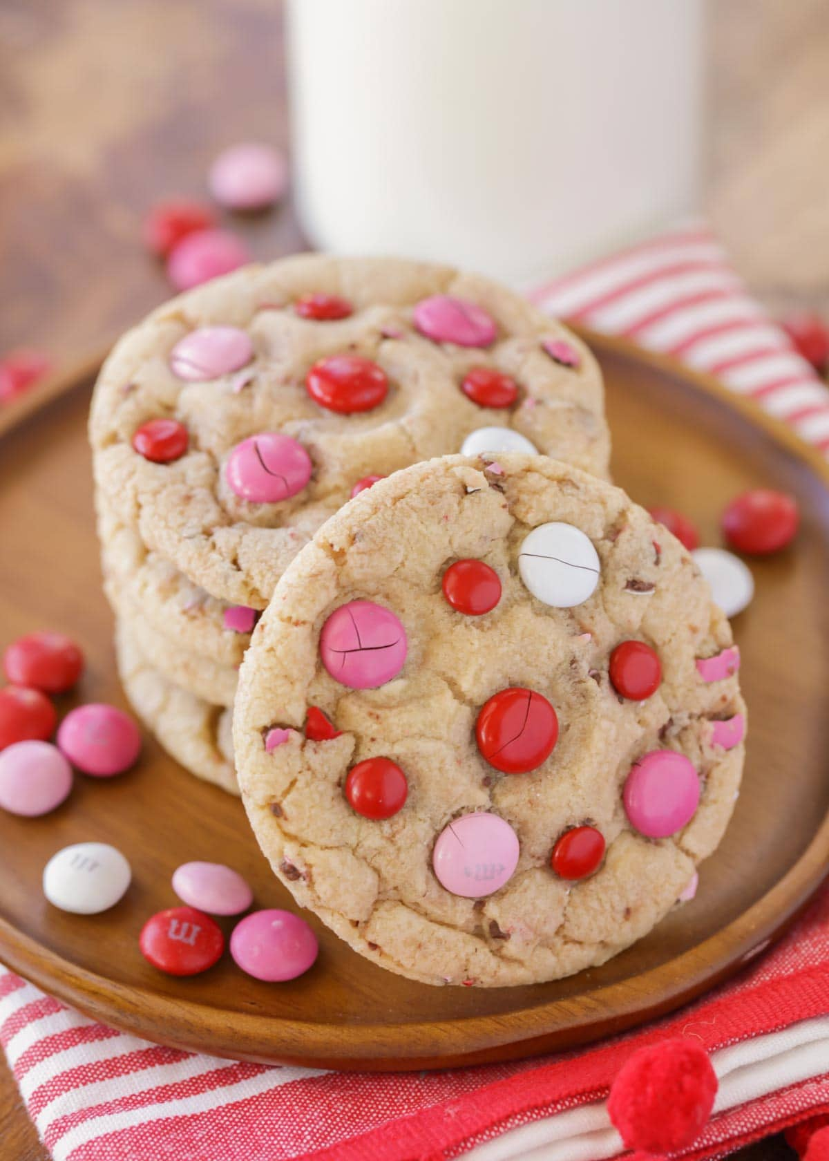 A stack of Valentines Day Cookies with pink and red M&Ms